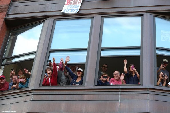 """""""Fans cheer from windows along Boylston Street during the Rolling Rally World Series Championship Parade through downtown Boston, Massachusetts Saturday, November 2, 2013."""""""
