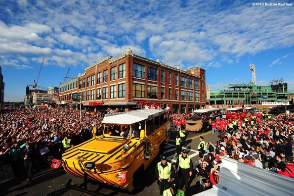 """""""Fans cheer as duck boats turn onto Boylston Street during the Rolling Rally World Series Championship Parade through downtown Boston, Massachusetts Saturday, November 2, 2013."""""""