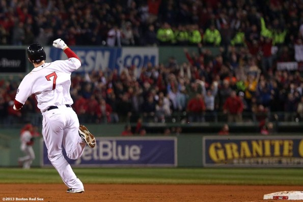 """""""Boston Red Sox shortstop Stephen Drew reacts after hitting a home run during the fourth inning of game six of the 2013 World Series against the St. Louis Cardinals Wednesday, October 30, 2013 at Fenway Park in Boston, Massachusetts."""""""