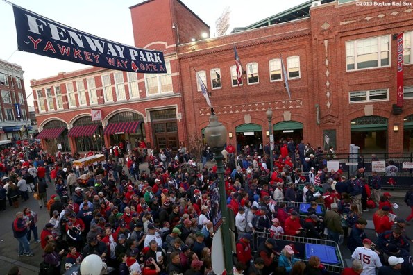 """""""Fans gather on Yawkey Way before game six of the 2013 World Series between the Boston Red Sox and the St. Louis Cardinals Wednesday, October 30, 2013 at Fenway Park in Boston, Massachusetts."""""""