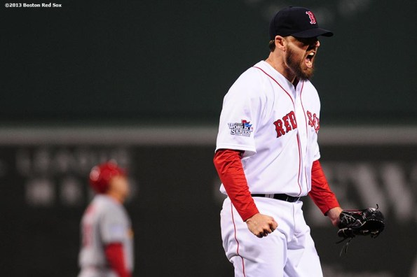 """""""Boston Red Sox pitcher John Lackey reacts after the fourth inning of game six of the 2013 World Series against the St. Louis Cardinals Wednesday, October 30, 2013 at Fenway Park in Boston, Massachusetts."""""""