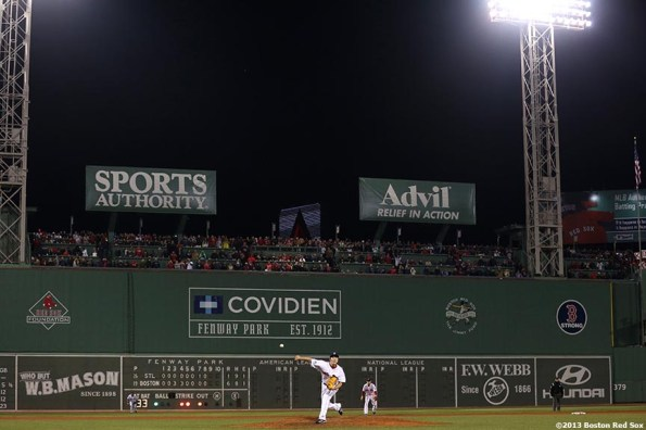 """""""Boston Red Sox pitcher Koji Uehara delivers during the ninth inning of game six of the 2013 World Series against the St. Louis Cardinals Wednesday, October 30, 2013 at Fenway Park in Boston, Massachusetts."""""""