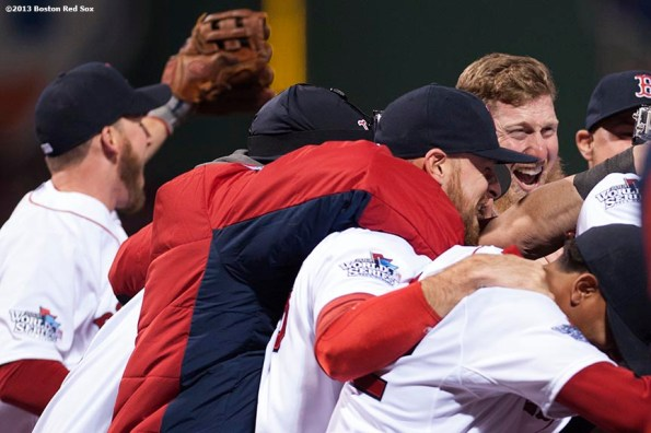 """""""Boston Red Sox players celebrate after defeating the St. Louis Cardinals 6-1 to win the 2013 World Series Wednesday, October 30, 2013 at Fenway Park in Boston, Massachusetts."""""""