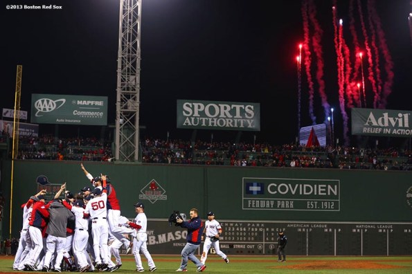 """""""Fireworks explode over the Green Monster as Boston Red Sox players celebrate after defeating the St. Louis Cardinals 6-1 to win the 2013 World Series Wednesday, October 30, 2013 at Fenway Park in Boston, Massachusetts."""""""