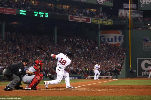 """""""Boston Red Sox right fielder Shane Victorino hits a three-RBI double during the third inning of game six of the 2013 World Series against the St. Louis Cardinals Wednesday, October 30, 2013 at Fenway Park in Boston, Massachusetts."""""""