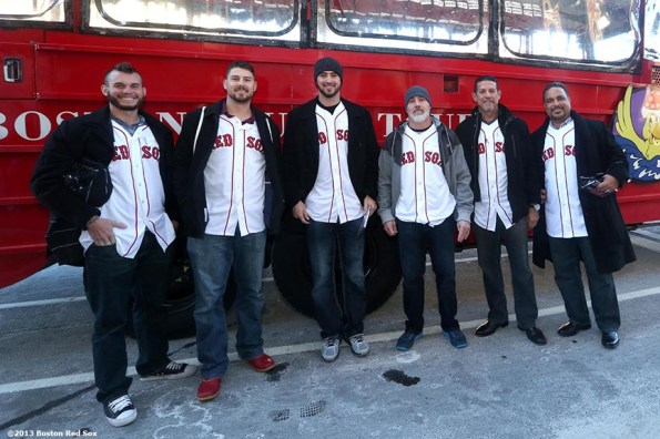 """""""Boston Red Sox players and coaches pose for a photograph outside a Duck Tour boat in Boston, Massachusetts Thursday, December 12, 2013 as part of the Red Sox Holiday Caravan to various locations throughout Boston."""""""
