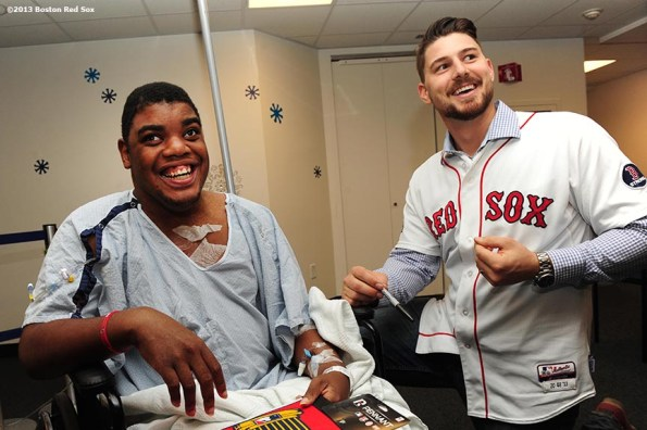 """""""Boston Red Sox catcher Ryan Lavarnway shares a laugh with a patient during a visit to Boston Children's Hospital Friday, December 13, 2013 as part of the Red Sox Holiday Caravan."""""""
