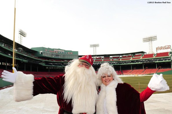 """""""Santa Claus and Mrs. Claus pose for a photograph during the annual Christmas at Fenway celebration Saturday, December 14, 2013, which featured speaking appearances and autograph sessions with players and coaches, holiday themed attractions and decorations, and opportunities for fans to purchase tickets for the 2014 season."""""""
