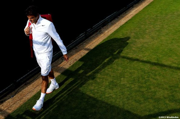 """""""Roger Federer walks off the Aorangi practice courts at the All England Lawn and Tennis Club in London, England Tuesday, June 25, 2013 during the 2013 Championships Wimbledon."""""""