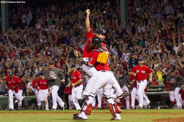 """""""Boston Red Sox teammates run out of the dugout in celebration as pitcher Koji Uehara and catcher Jarrod Saltalamacchia embrace after recording the final out of a 6-3 win over the Toronto Blue Jays to clinch the American League East title at Fenway Park Friday, September 23, 2013."""""""