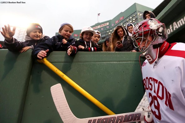 """""""A Boston University goalie walks through the dugout tunnel before a game against the University of Maine at Frozen Fenway Saturday, January 11, 2014 at Fenway Park in Boston, Massachusetts."""""""