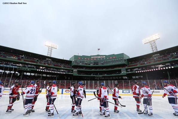 """""""University of Massachusetts Lowell players shake hands with Northeastern University players after a game Saturday, January 11, 2014 at Fenway Park in Boston, Massachusetts."""""""