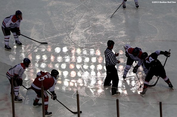 """""""Game action during a game between University of Massachusetts Lowell and Northeastern University at Frozen Fenway Saturday, January 11, 2014 at Fenway Park in Boston, Massachusetts."""""""