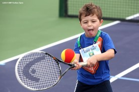 """""""A boy plays tennis during Kids Day at the Indian Wells Tennis Garden sponsored by the Coachella Valley National Junior Tennis and Learning Network Saturday, March 1, 2014 in Indian Wells, California."""""""