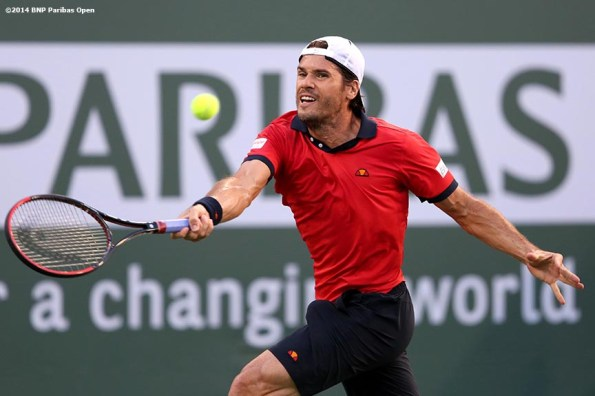 """""""Tommy Haas returns a shot from Roger Federer at the 2014 BNP Paribas Open Wednesday, March 12, 2014 in Indian Wells, California."""""""