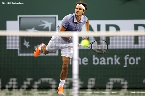 """""""Tommy Haas plays Roger Federer at the 2014 BNP Paribas Open Wednesday, March 12, 2014 in Indian Wells, California."""""""