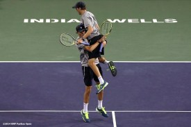 """""""Bob and Mike Bryan react after defeating Alexander Peya and Bruno Soares to win the 2014 BNP Paribas Open doubles championship Saturday, March 15, 2014 in Indian Wells, California."""""""