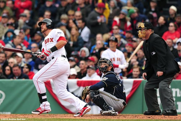 """""""Boston Red Sox third baseman Will Middlebrooks hits a solo home run during the third inning of the 2014 home opener against the Milwaukee Brewers Friday, April 4, 2014 at Fenway Park in Boston, Massachusetts."""""""