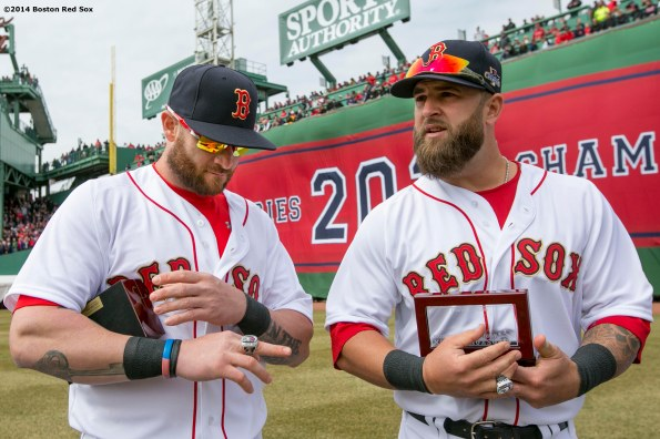 """""""Boston Red Sox left fielder Jonny Gomes and first baseman Mike Napoli receive their rings during the World Series ring ceremony at the 2014 season home opener Friday, April 4, 2014 at Fenway Park in Boston, Massachusetts."""""""
