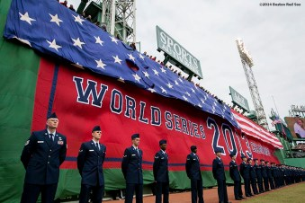 """""""Members of the Hanscom Air Force Base assist in a flag drop of the American flag during the Boston Red Sox World Series ring ceremony at the 2014 season home opener Friday, April 4, 2014 at Fenway Park in Boston, Massachusetts."""""""