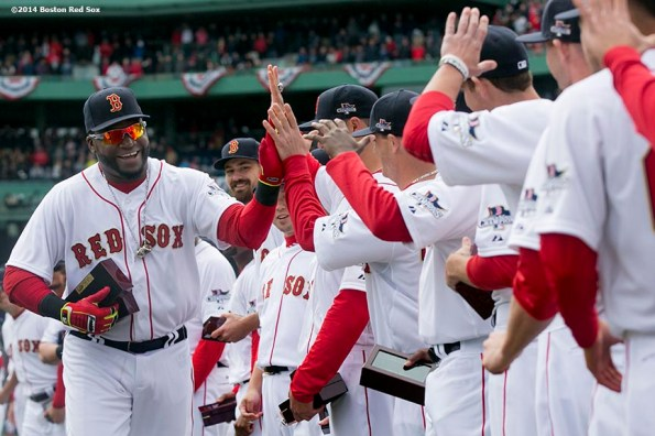 """""""Boston Red Sox designated hitter David Ortiz high fives teammates during the World Series ring ceremony at the 2014 season home opener Friday, April 4, 2014 at Fenway Park in Boston, Massachusetts."""""""