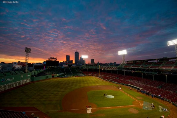 """""""The sun rises over Fenway Park on the morning of the 2014 Boston Red Sox home opener Friday, April 4, 2014 in Boston, Massachusetts."""""""