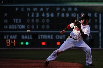 """""""Boston Red Sox second baseman Dustin Pedroia fields a ground ball during the sixth inning of a game against the Texas Rangers at Fenway Park in Boston, Massachusetts Wednesday, April 9, 2014."""""""