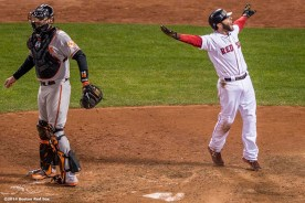 """""""Boston Red Sox second baseman Dustin Pedroia reacts after scoring the winning run on a throwing error in the ninth inning of a game against the Baltimore Orioles at Fenway Park Sunday, April 20, 2014. The Red Sox won 6-5."""""""
