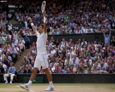 """""""Novak Djokovic reacts after winning match point to defeat Roger Federer in the gentlemen's singles final against Roger Federer at the All England Lawn and Tennis Club in London, England Sunday, July 6, 2014 during the 2014 Championships Wimbledon."""""""