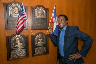 """""""Former Boston Red Sox pitcher Pedro Martinez poses next to his Boston Red Sox Hall of Fame plaque after being informed that he was inducted into the Major League Baseball Hall of Fame at Fenway Park in Boston, Massachusetts Tuesday, January 6, 2015."""""""