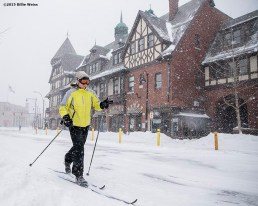"""""""A skier skis down Harvard Avenue during snow storm Juno in Brookline, Massachusetts Tuesday, January 27, 2015."""""""