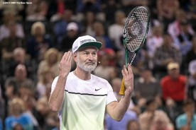"""""""John McEnroe reacts during the McEnroe Challenge for Charity presented by Masimo in Stadium 2 at the Indian Wells Tennis Garden in Indian Wells, California Saturday, March 7, 2015."""""""