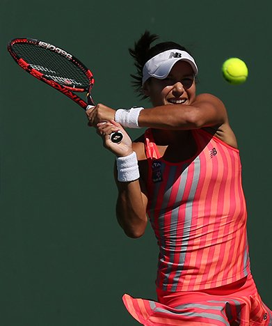 """""""Heather Watson in action against Camila Giorgi during their second round match at the Indian Wells Tennis Garden in Indian Wells, California on Friday, March 13, 2015."""""""