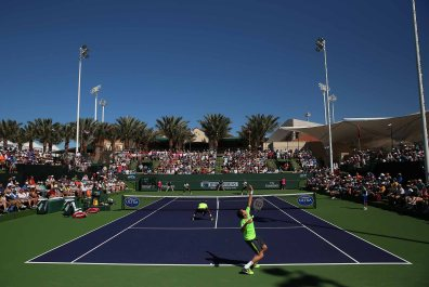 """""""Aisam-Ul-Haq Qureshi and Milos Raonic in action against Raven Klaasen and Leander Paes during their doubles match on Stadium 9 at the Indian Wells Tennis Garden in Indian Wells, California on Friday, March 13, 2015."""""""