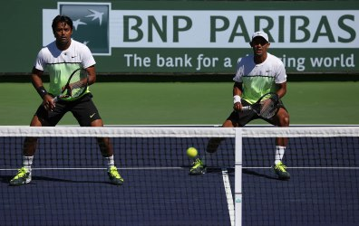 """""""Raven Klaasen and Leander Paes in action against Aisam-Ul-Haq Qureshi and Milos Raonic during their doubles match on Stadium 9 at the Indian Wells Tennis Garden in Indian Wells, California on Friday, March 13, 2015."""""""