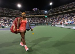 """""""Serena Williams walks off of the court following her win against Monica Niculescu during their match at Stadium 1 at the Indian Wells Tennis Garden in Indian Wells, California on Friday, March 13, 2015."""""""