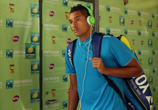 """""""Nick Kyrgios walks through the tunnel prior to his match against Grigor Dimitrov at stadium 1 at the Indian Wells Tennis Garden in Indian Wells, California on Sunday, March 15, 2015."""""""