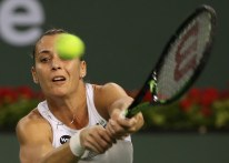 """""""Flavia Pennetta in action against Maria Sharapova at stadium 1 at the Indian Wells Tennis Garden in Indian Wells, California on Tuesday, March 17, 2015."""""""