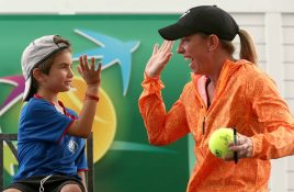 """""""Lisa Raymond high fives a young fan during a Tennis Talk at the Indian Wells Tennis Garden in Indian Wells, California Wednesday, March 18, 2015."""""""