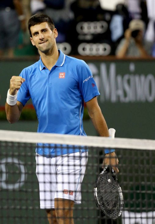 """""""A fourth round match between Novak Djokovic and John Isner on Stadium 1 during the 2015 BNP Paribas Open in Indian Wells, California on Wednesday, March 18, 2015."""""""