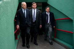 """""""Boston Red Sox President & CEO Larry Lucchino, Boston Mayor Marty Walsh, and Chairman Tom Werner walk up a concourse into the stadium during a walk through of Fenway Park in Boston, Massachusetts Monday, April 6, 2015."""""""