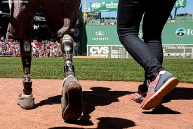 """""""Boston Marathon bombing survivor Jeff Bauman walks toward the pitchers mound before throwing out the ceremonial first pitch before a game against the Washington Nationals at Fenway Park in Boston, Massachusetts Wednesday, April 15, 2015."""""""