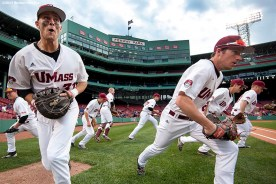 """""""University of Massachusetts take the field before the Championship game between Boston College and University of Massachusetts as part of the Baseball Beanpot at Fenway Park in Boston, Massachusetts Wednesday, April 22, 2015."""""""