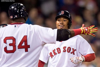 """""""Boston Red Sox centerfielder Mookie Betts is congratulated by designated hitter David Ortiz after hitting a solo home run during the eighth inning of a game against the Tampa Bay Rays at Fenway Park in Boston, Massachusetts Tuesday, May 5, 2015. It was his second home run of the game."""""""