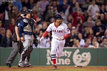 """""""Boston Red Sox centerfielder Mookie Betts hits a solo home run during the eighth inning of a game against the Tampa Bay Rays at Fenway Park in Boston, Massachusetts Tuesday, May 5, 2015. It was his second home run of the game."""""""