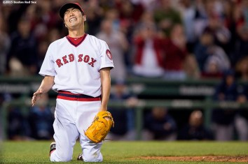 """""""Boston Red Sox pitcher Koji Uehara reacts after recording the final out to defeat theTampa Bay Rays at Fenway Park in Boston, Massachusetts Tuesday, May 5, 2015."""""""