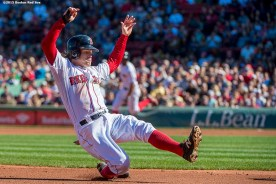 """""""Boston Red Sox second baseman Brock Holt slides into third base during the first inning of a game against the Baltimore Orioles at Fenway Park in Boston, Massachusetts Sunday, September 27, 2015."""""""