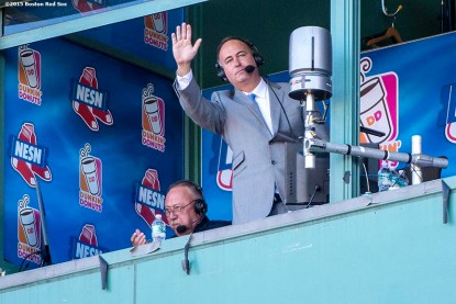 """""""NESN Broadcaster Don Orsillo waves to the crowd from the booth as he is honored during his last game with NESN during a game between the Boston Red Sox and the Baltimore Orioles at Fenway Park in Boston, Massachusetts Sunday, September 27, 2015."""""""