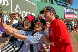 """""""Pitcher Koji Uehara poses for a selfie photograph during on-field photo day before a game between the Boston Red Sox and the Baltimore Orioles at Fenway Park in Boston, Massachusetts Sunday, September 27, 2015."""""""