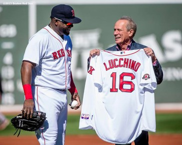 """""""Boston Red Sox President & CEO Larry Lucchino is presented with a jersey commemorating him as a member of the Boston Red Sox hall of fame by designated hitter David Ortiz during a tribute ceremony for him before a game between the Boston Red Sox and the Baltimore Orioles at Fenway Park in Boston, Massachusetts Sunday, September 27, 2015."""""""